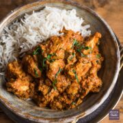 Chicken tikka masala curry in a bowl with rice.