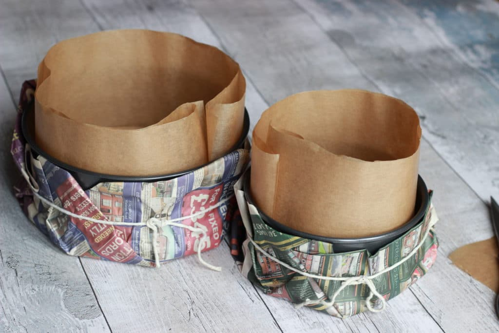 8 inch and 6 inch cake tins lined and wrapped in newspaper