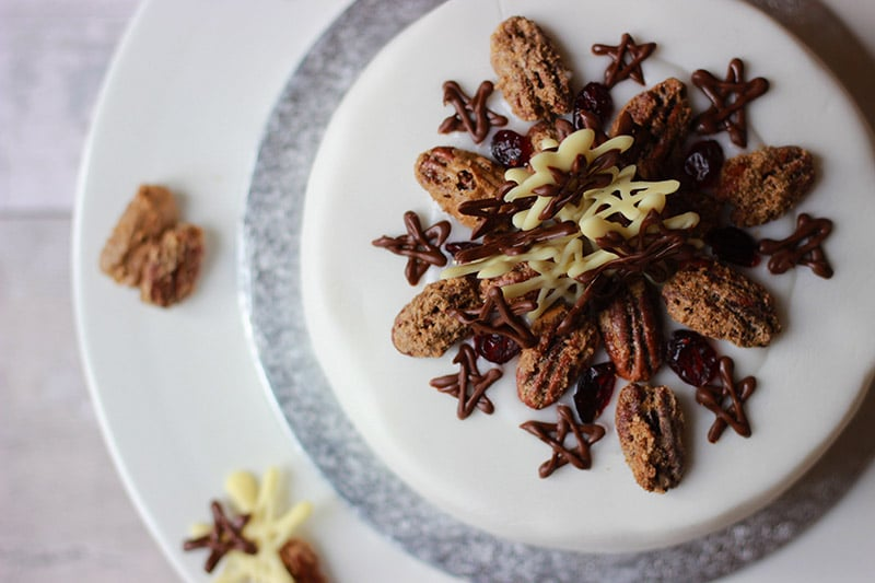 properfoodie christmas cake with chocolate decor and sugared pecans