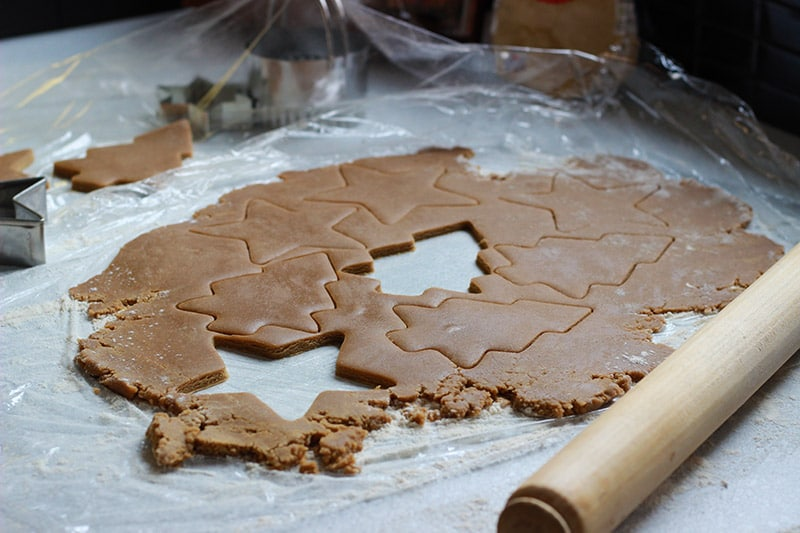cutting out gingerbread biscuits