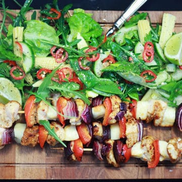 chicken skewers with rocket, lime and baby corn salad