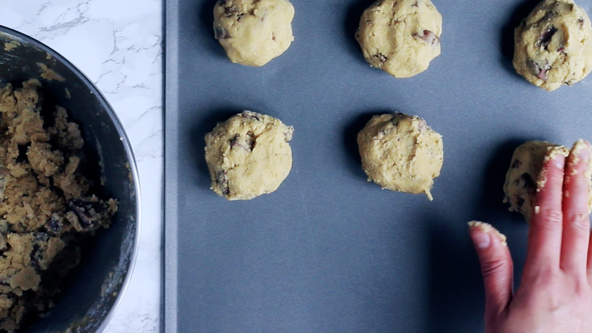 making balls out of cookie dough