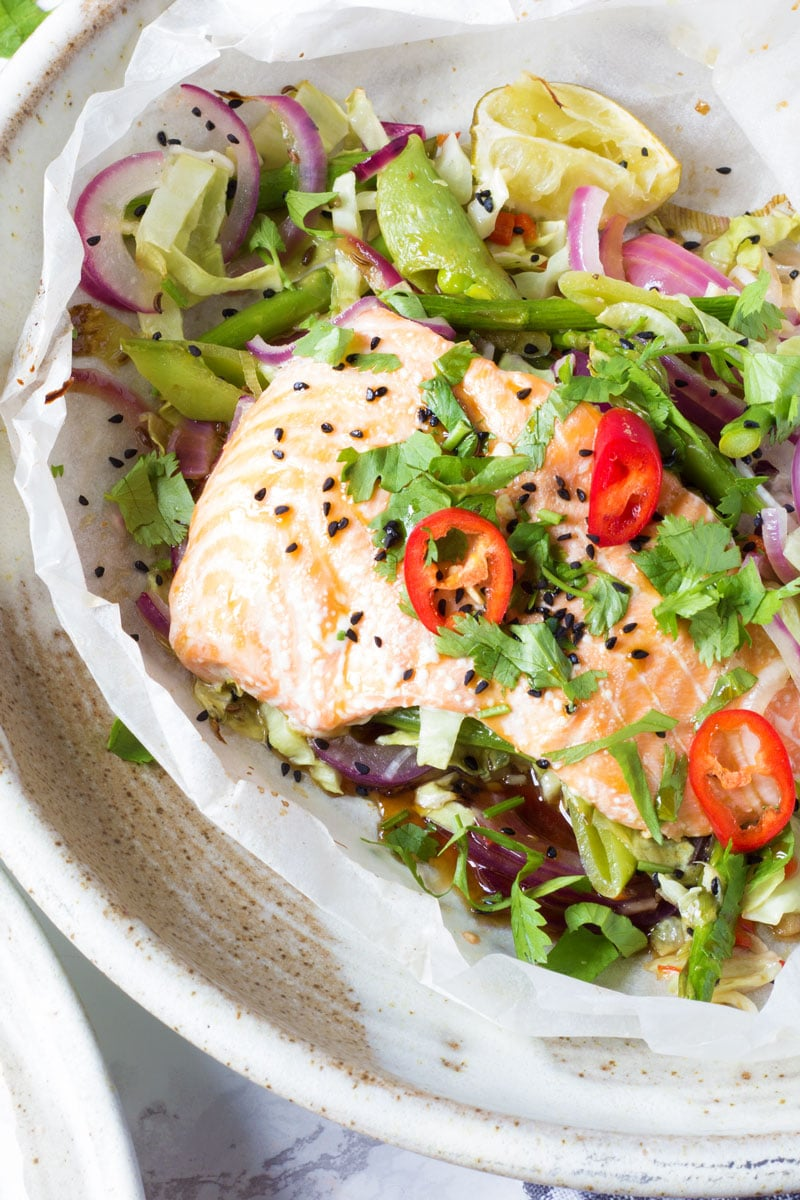Salmon and Asian salad with fresh coriander and onion seed