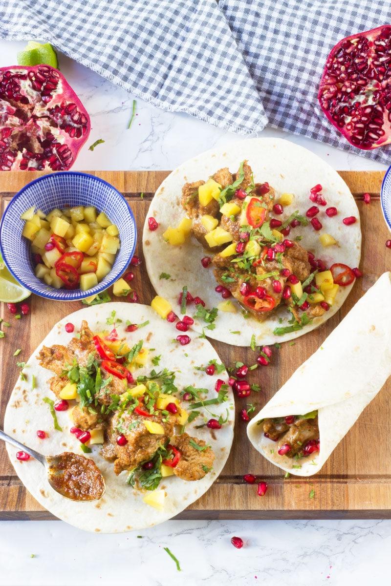 jerk chicken and pomegranate tacos