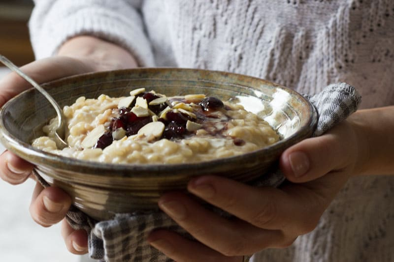 rice pudding with cherry sauce and almonds eat yourself happy