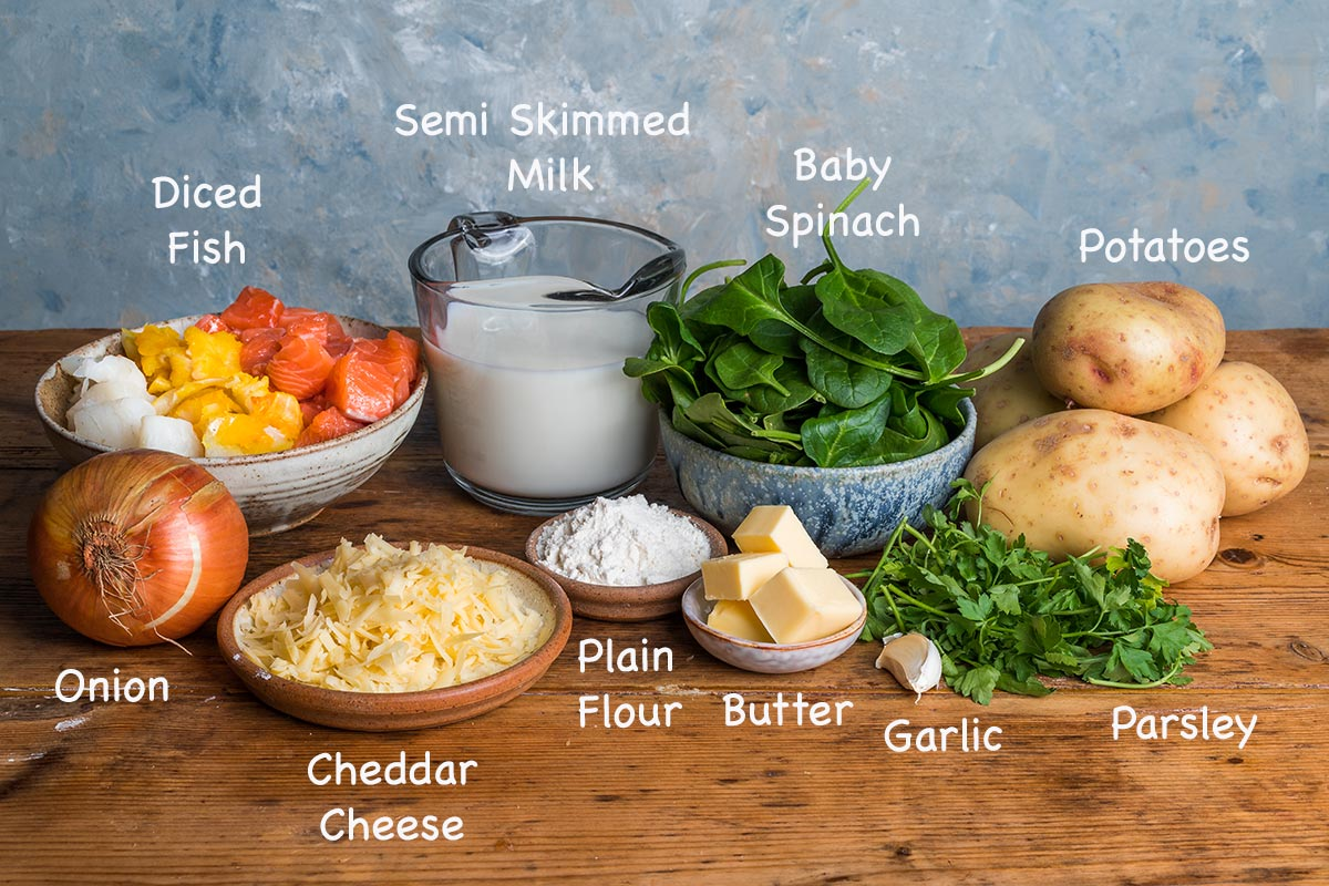 A display of the ingredients needed to make this classic fish pie recipe with text overlay stating each ingredients.
