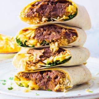beef brisket burritos with rice and coleslaw