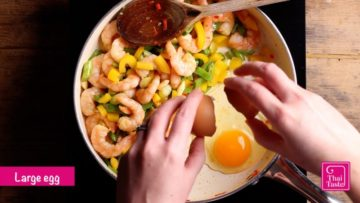 move the pad thai ingredients to one side of the pan, crack in an egg and scramble