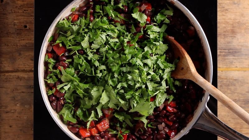 add fresh coriander to black beans