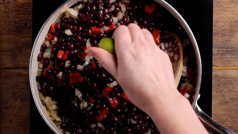 squeeze of lime and salt and pepper to black beans