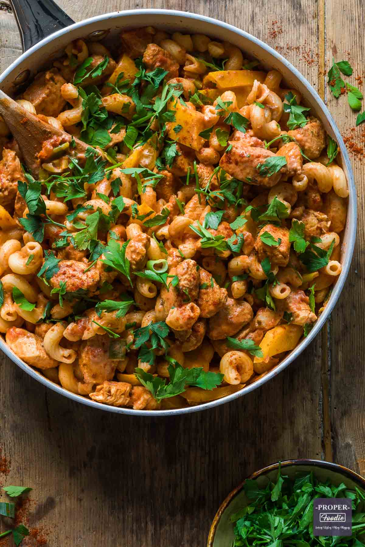 A large pan filled with Cajun chicken pasta.