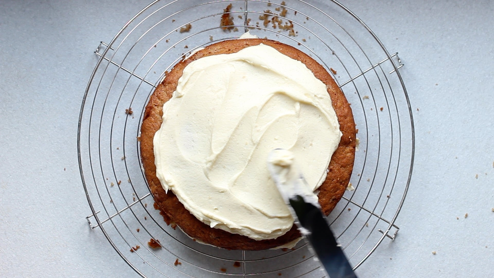 Top the cake with the remaining half of cream cheese frosting