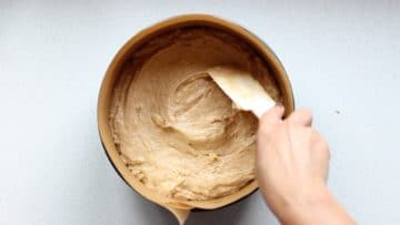 Transfer the banana cake mix to a lined cake tin