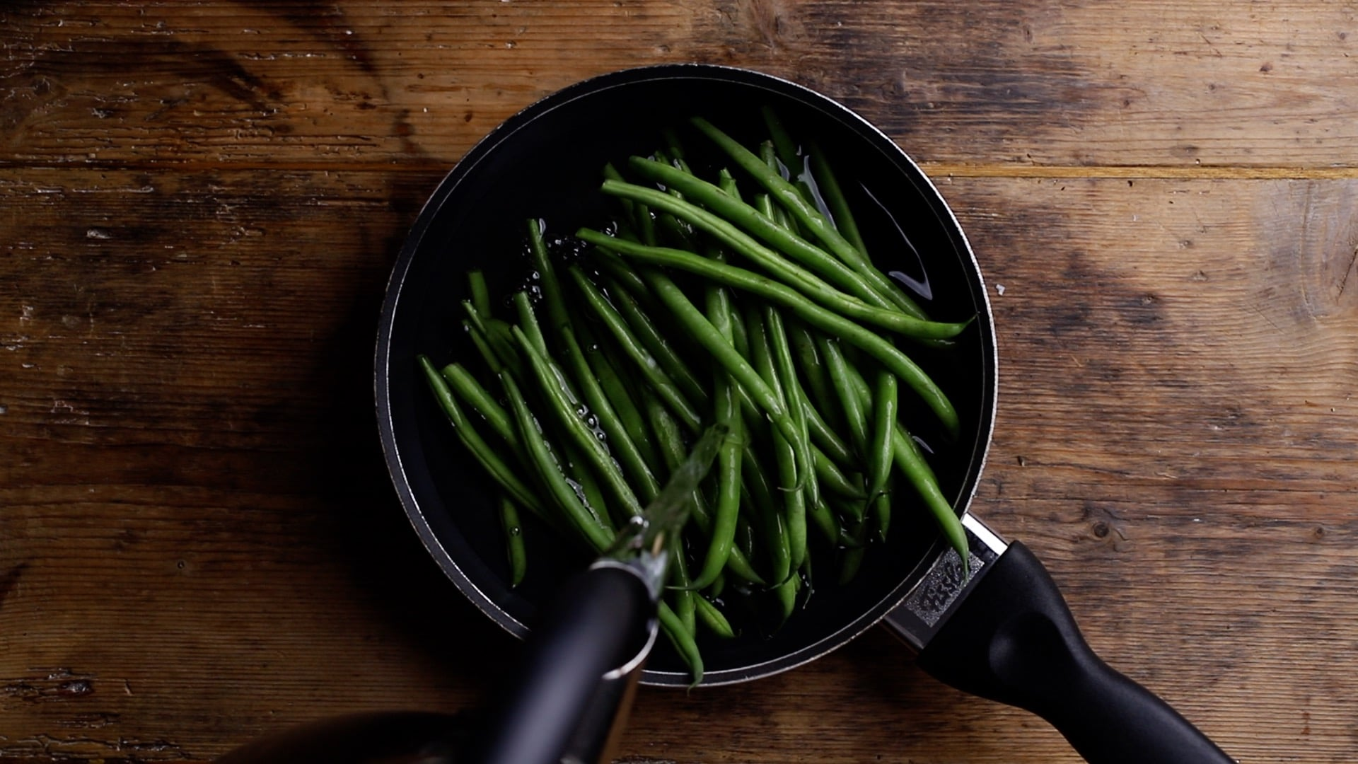 add water to green beans and simmer