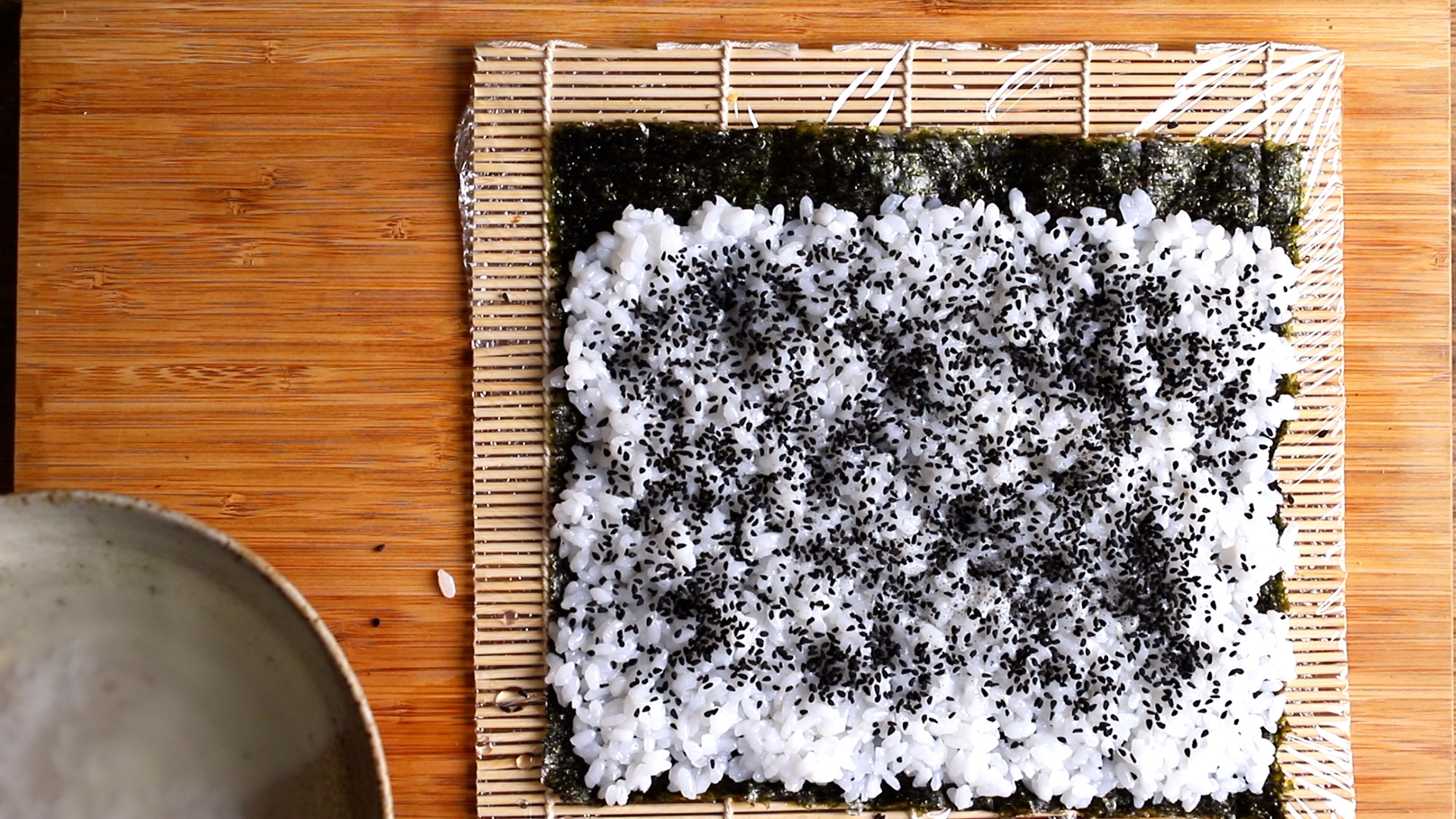 black sesame seed on top of rice for california roll