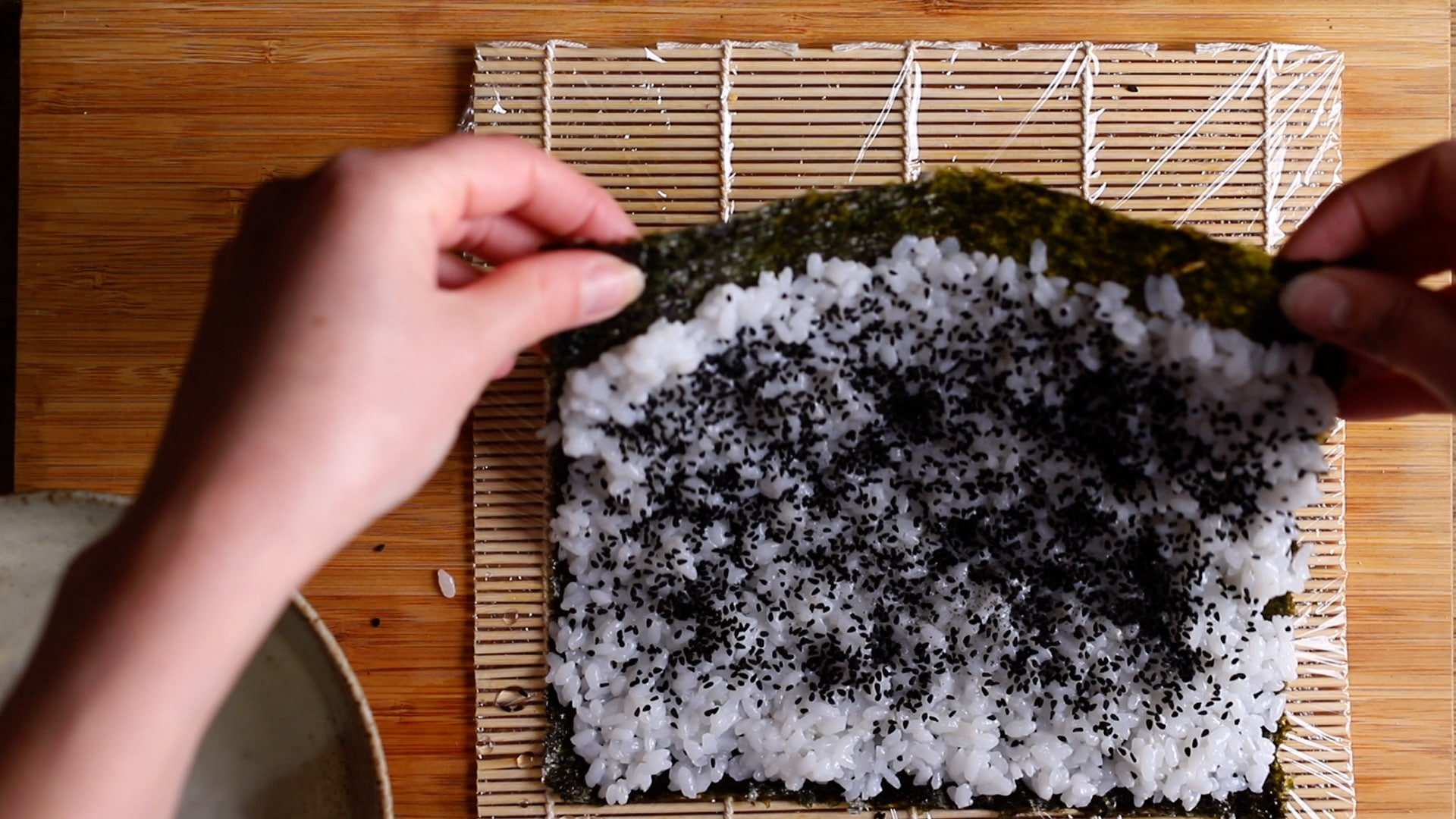 flip over rice and nori so rice is on the underside