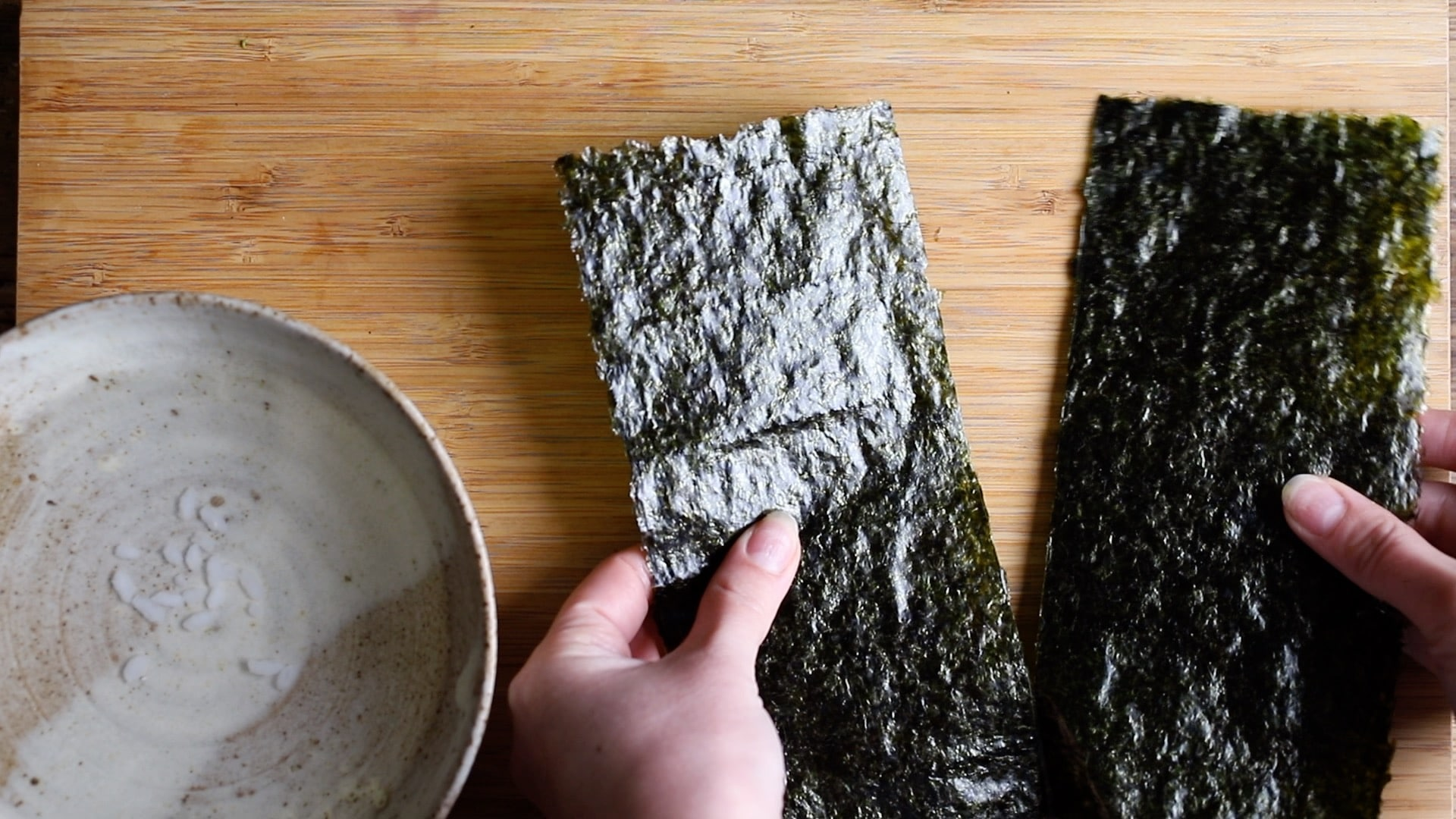 for maki sushi fold and cut the sheet of nori in half