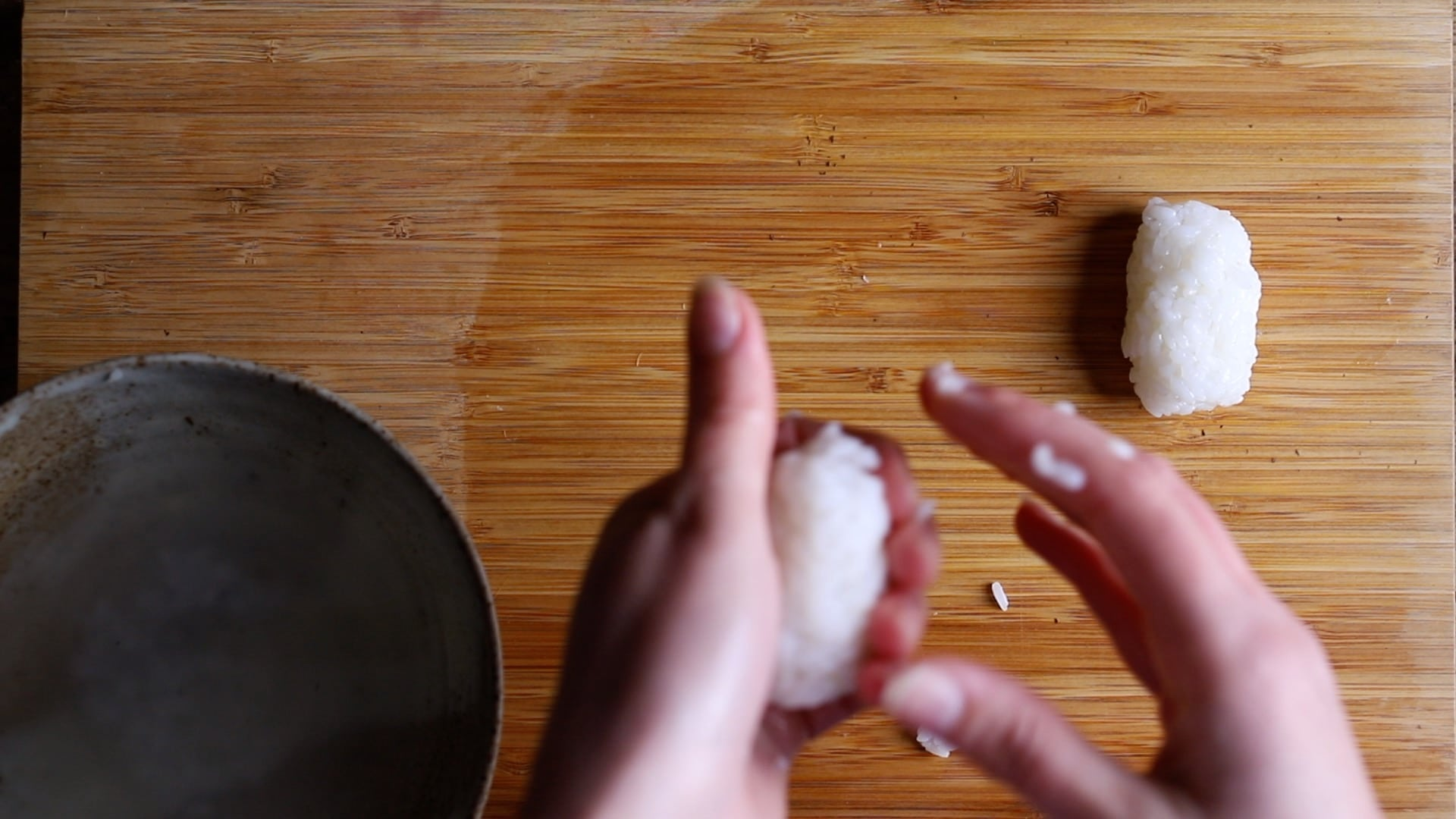 shaping the rice into small oblong balls