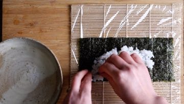 spread the rice thinly and evenly leaving a boarder at the top edge
