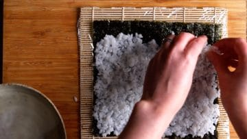 thin layer of rice on rough side or nori sheet
