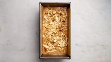 scatter over flaked almonds and chopped walnuts then bake