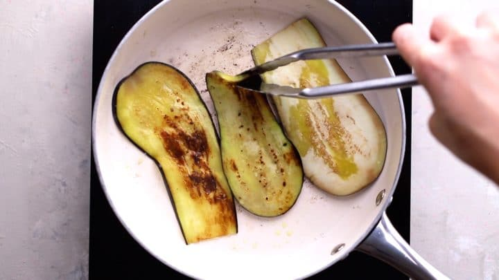 frying aubergine slices