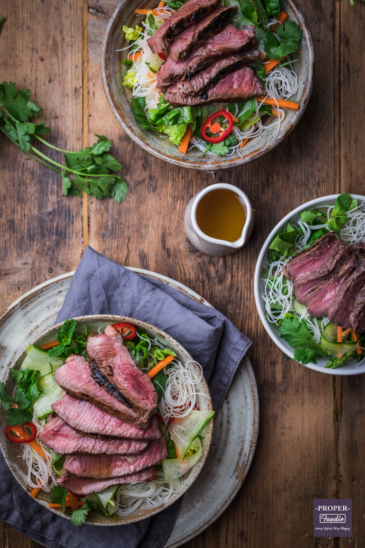 Vietnamese style noodle salad recipe wth sliced steak served up in 2 bowls