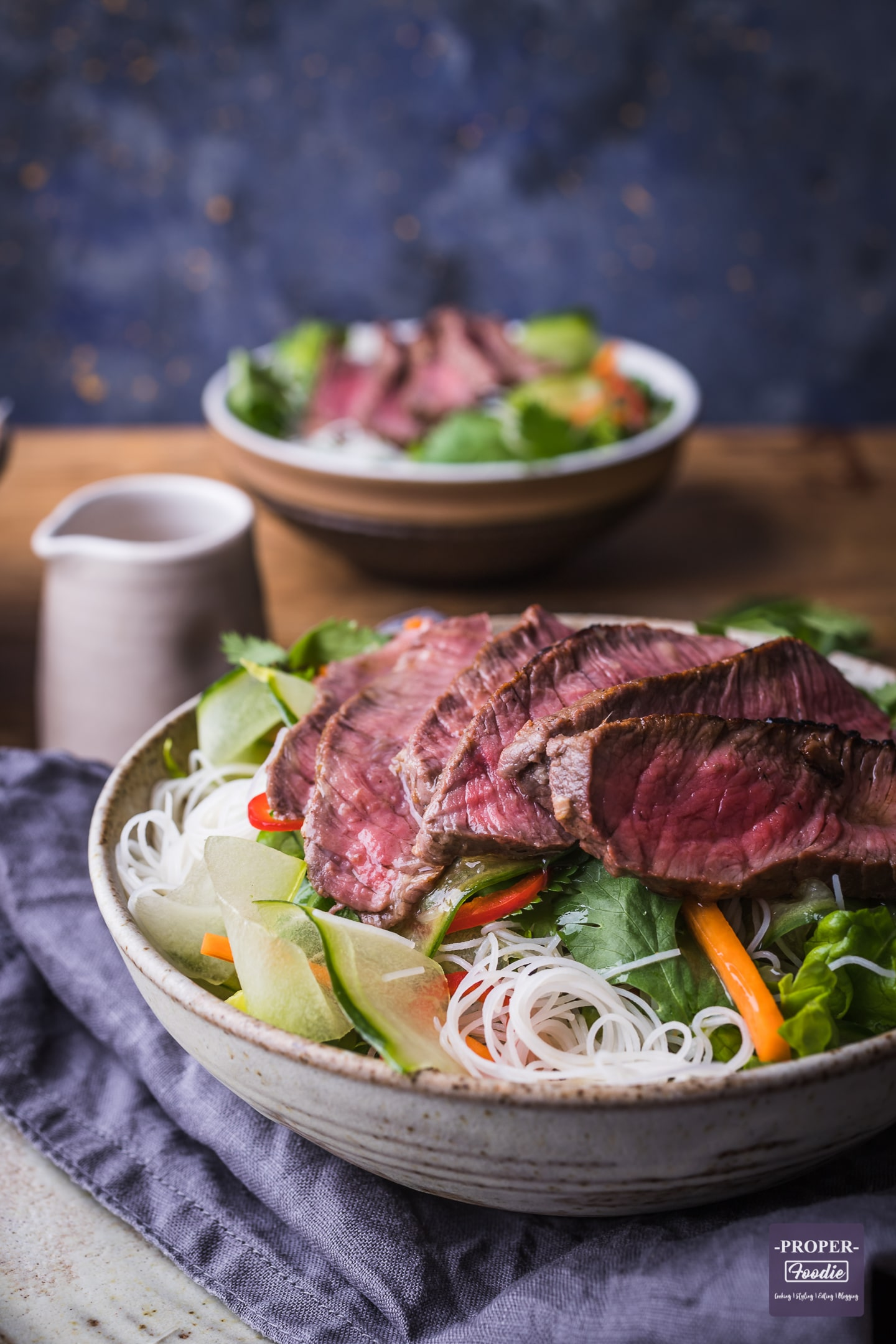 beef rice noodle salad served in a bowl