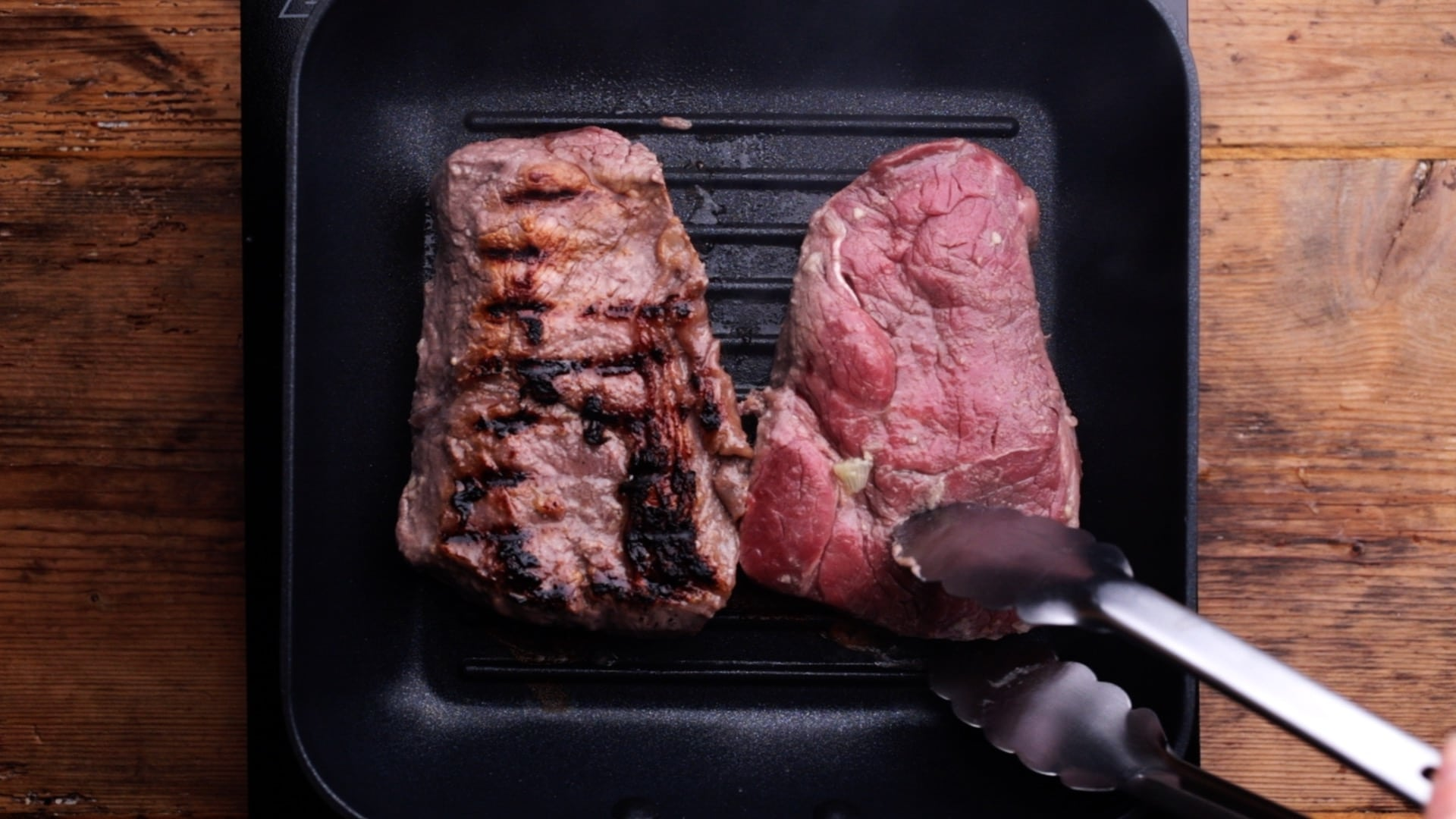 frying steaks in griddle pan