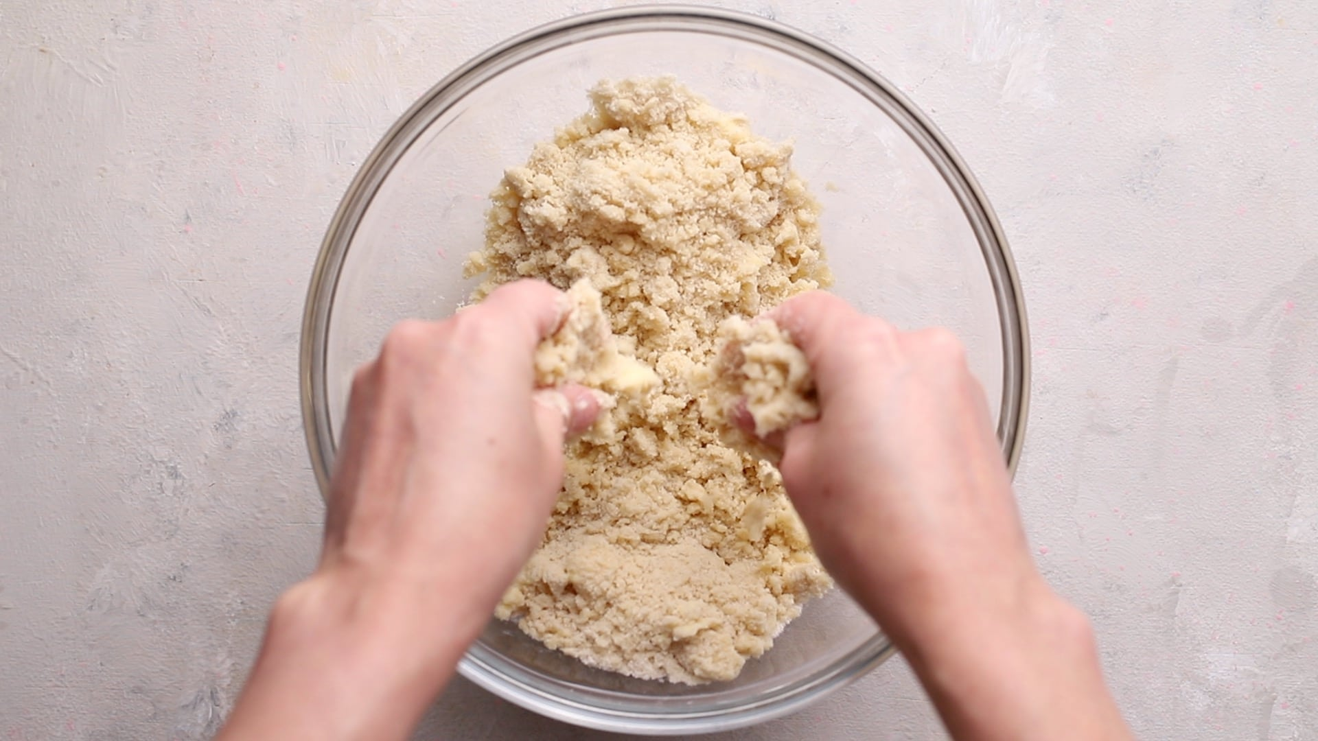 rubbing butter and flour together into breadcrumbs