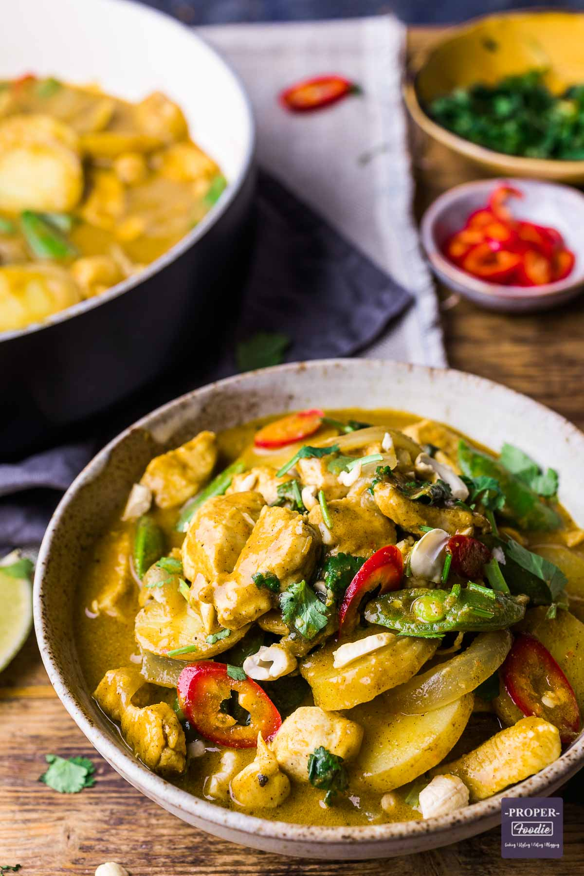 A bowl of chicken and potato curry in a coconut cream sauce.