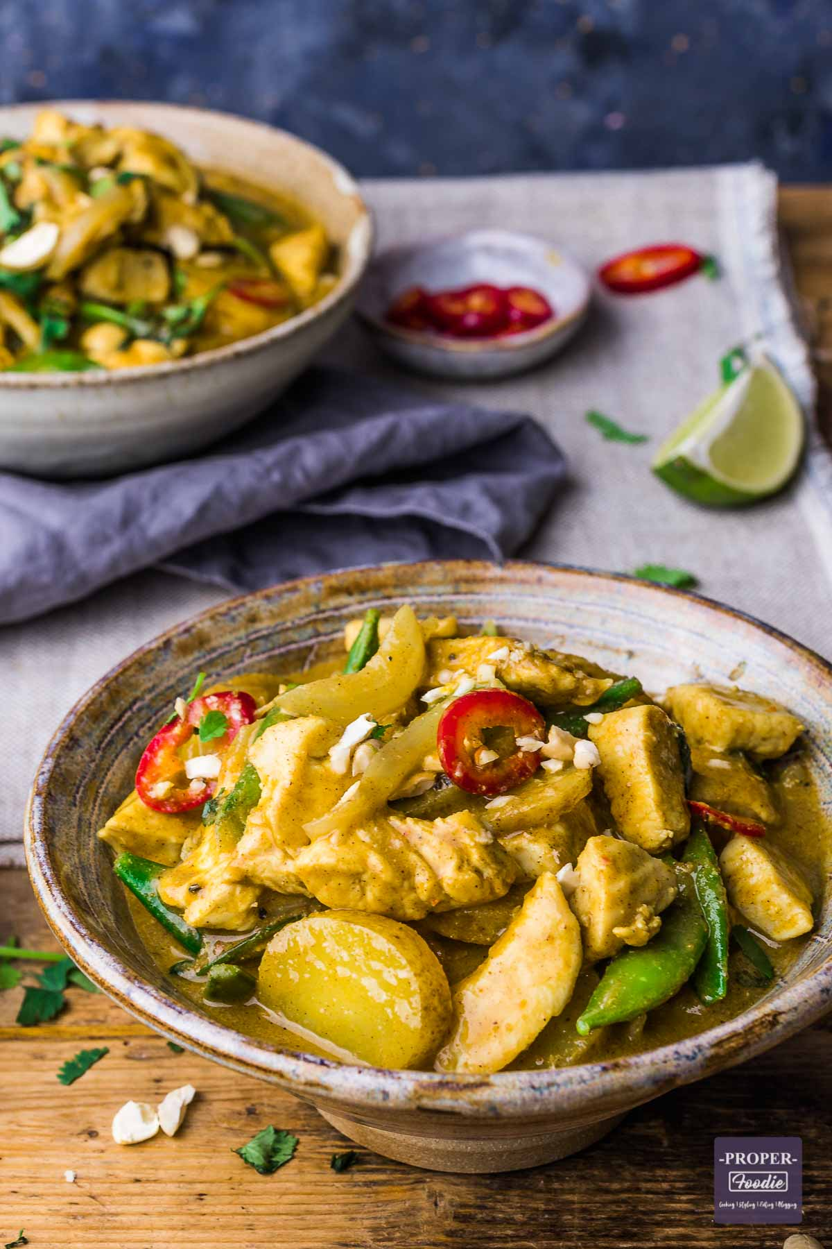 A bowl of Thai curry made with chicken, sliced potatoes and massaman curry sauce.
