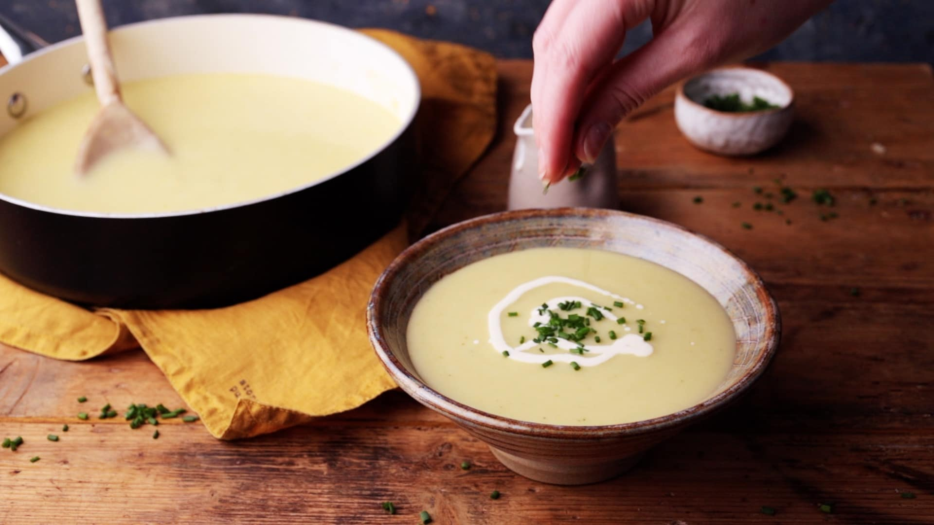 leek and potato soup served with cream and chopped chives