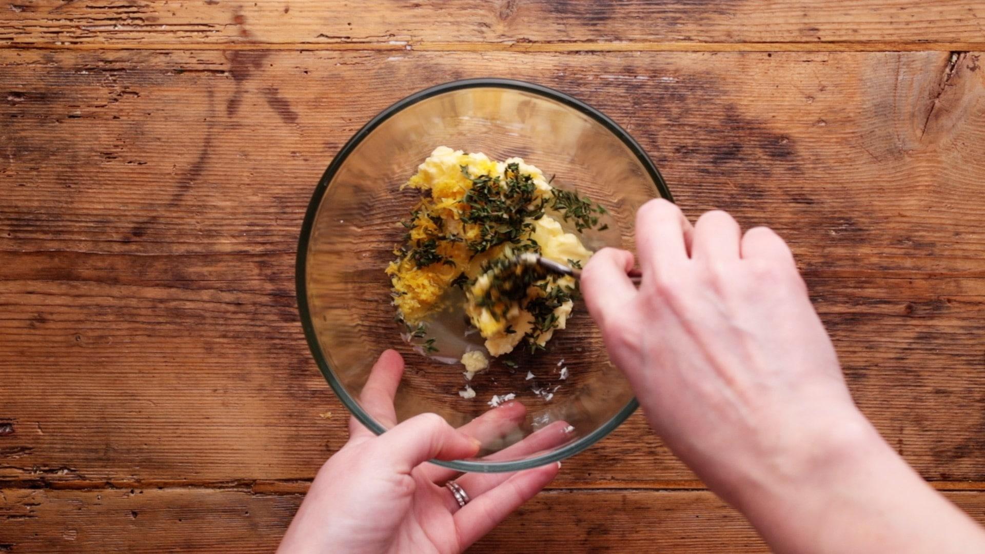 making lemon garlic and herb butter