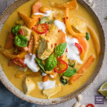 Thai Panang curry in a bowl with yogurt and fresh chillies