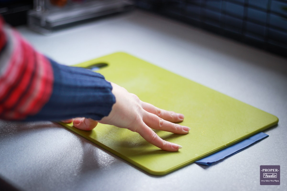rubber glove under a chopping board to stop it slipping