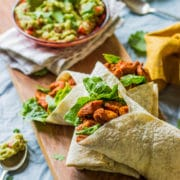 Healthy chicken wraps with paprika chicken and lettuce
