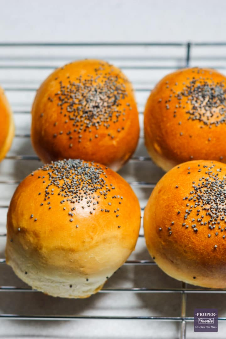 freshly baked bread rolls cooling on a wire rack