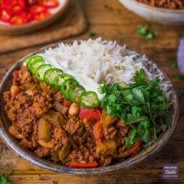 chilli con carne in a bowl with cannellini beans and rice.