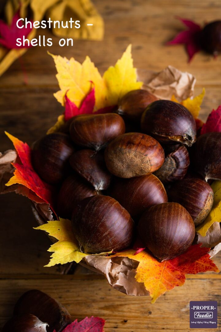 Ingredients for roast chestnuts: Bowl of chestnuts with shells on.