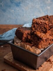 Yorkshire parkin sliced up and presented piled on top of one another in a loaf tin.
