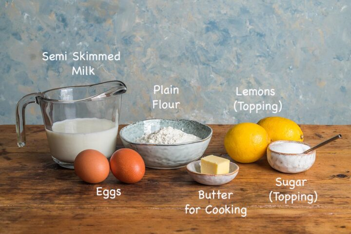 A display of the ingredients needed to make English pancakes recipe with text overlay stating each ingredients.