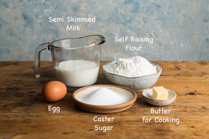A display of the ingredients needed to make Scotch pancakes recipe with text overlay stating each ingredients.