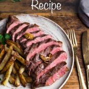 Rump steak cooked medium-rare. sliced into strips and resented on a plate with home made chips on the side.
