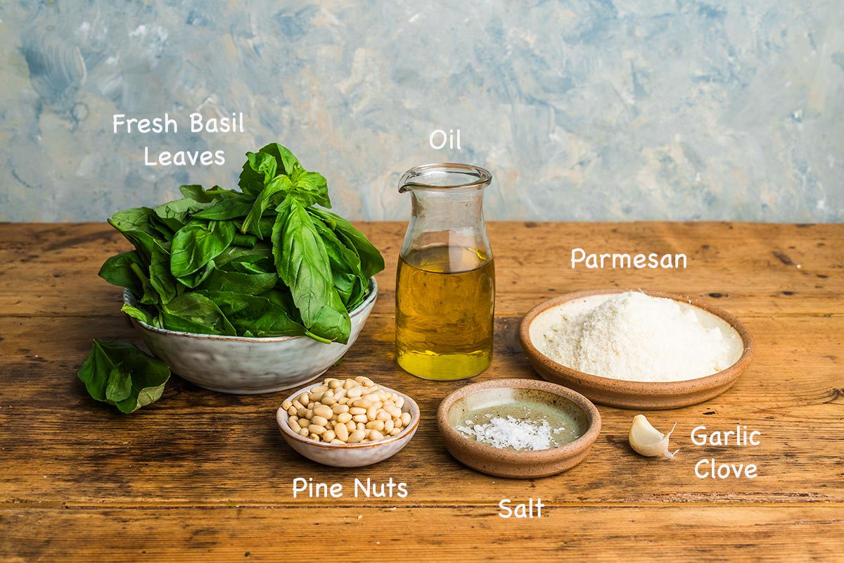 The ingredients required to make homemade basil pesto.